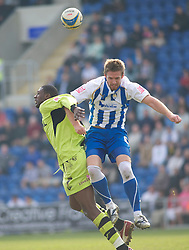 COLCHESTER, ENGLAND - Saturday, April 24, 2010: Tranmere Rovers' Bas Savage is pushed in back by Colchester United's Paul Reid during the Football League One match at the Western Community Stadium. (Photo by Gareth Davies/Propaganda)