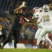 08 October 2016: The San Diego State Aztecs football team open's up the mountain west conference season at home against the University of Nevada Las Vegas Rebels.  San Diego State defensive linemen Alex Barrett (58) seen here rushing the quarterback in the fourth quarter. The Aztecs beat the Rebels 26-7 to improve to 4-1 and 1-0 in conference play. www.sdsuaztecphotos.com