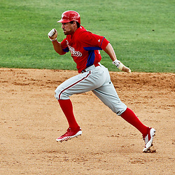 March 20, 2012; Sarasota, FL, USA; Philadelphia Phillies left fielder Scott Podsednik (22) advances to third base on a Brian Schneider single during the top of the eighth inning of a spring training game at Ed Smith Stadium.  Mandatory Credit: Derick E. Hingle-US PRESSWIRE