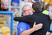 Mansfield Town manager Steve Evans greets Luton Town manager Nathan Jones before the EFL Sky Bet League 2 match between Mansfield Town and Luton Town at the One Call Stadium, Mansfield, England on 26 August 2017. Photo by Nigel Cole.
