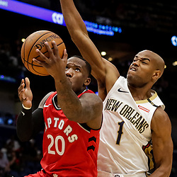 Oct 11, 2018; New Orleans, LA, USA; Toronto Raptors guard Kay Felder (20) shoots over New Orleans Pelicans guard Jarrett Jack (1) during the second half at the Smoothie King Center. Mandatory Credit: Derick E. Hingle-USA TODAY Sports