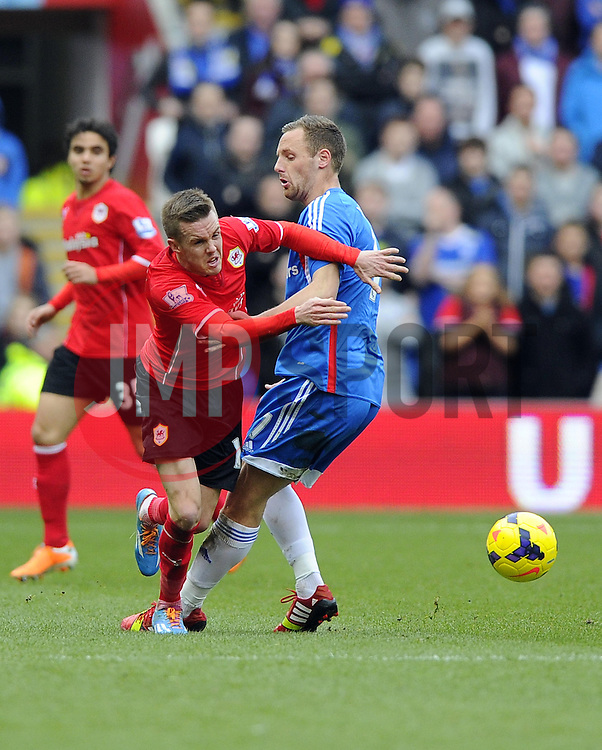 Cardiff City's Craig Noone battles for the ball with Hull City's David Meyler - Photo mandatory by-line: Joe Meredith/JMP - Tel: Mobile: 07966 386802 22/02/2014 - SPORT - FOOTBALL - Cardiff - Cardiff City Stadium - Cardiff City v Hull City - Barclays Premier League