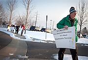 Gun regulation protestor Stan Holmes walks towards the South Towne Expo Center during the 2013 Rocky Mountain Gun Show, Saturday, Jan. 5, 2013.