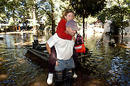 NEW HOPE, PA - SEPTEMBER 20: Mark Hackman carries his wife Lori Hackman through flood waters September 20, 2004 in Yardley, Pennsylvania. Rain from Hurricane Ivan in upstate Pennsylvania and New York caused the worst flooding along the Delaware River in 50 years. Pennsylvania Governor Ed Rendell and New Jersey Governor James McGreevey called states of emergency in numerous counties in their respective states. 6 people died due to the flooding in Pennsylvania.  (Photo by William Thomas Cain/Getty Images)