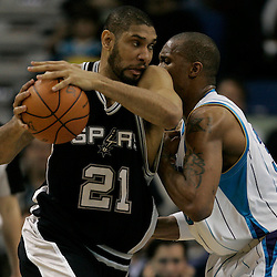 Mar 01, 2010; New Orleans, LA, USA; San Antonio Spurs center Tim Duncan (21) is defended by New Orleans Hornets forward David West (30) during the second half at the New Orleans Arena. The Spurs defeated the Hornets 106-92. Mandatory Credit: Derick E. Hingle-US PRESSWIRE