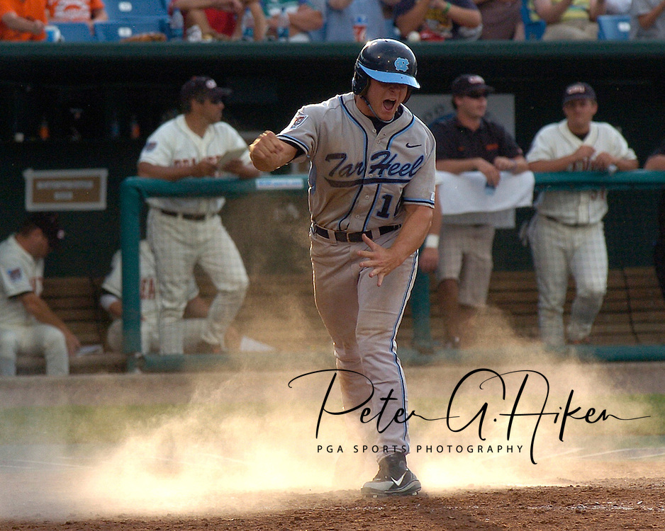 North Carolina's Tim Federowicz reacts after scoring the Tar Heels first run in the fifth inning.  Oregon State defeated North Carolina 3-2 for the National Championship at the College World Series at Rosenblatt Stadium in Omaha, Nebraska, June 26, 2006.