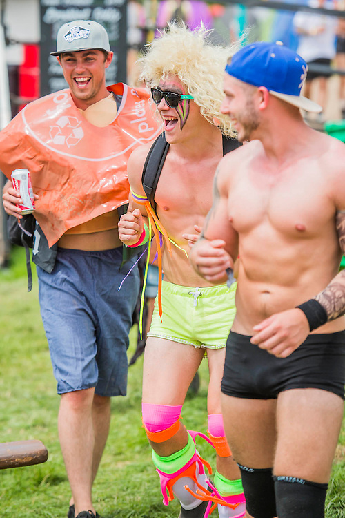Early arrivals can enjoy the  blistering heat in sunglasses and stripped down fancy dress. The 2015 Glastonbury Festival, Worthy Farm, Glastonbury.