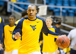 Nov 20, 2015; Morgantown, WV, USA; West Virginia Mountaineers guard Jevon Carter warms up before their game against the Stetson Hatters at WVU Coliseum. Mandatory Credit: Ben Queen-USA TODAY Sports