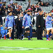 With legendary singer, Lapi Mariner by their side, Manu Samoa walks out on the playing field.   All Blacks entrance was a healthy sprint.  The New Zealand All Blacks defeated Manu Samoa 15's 83-0 at Eden Park, Auckland, New Zealand.  Photo by Barry Markowitz, 6/16/17