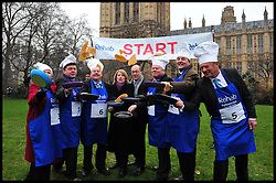 The Lords team take part in the MP's and Lords race against political Journalist in the Rehab Parliamentary Pancake Shrove Tuesday race a charity event which sees MPs and Lords joined by media types in a race to the finish. Victoria Tower Gardens, Westminster, Tuesday February 12, 2013. Photo By Andrew Parsons / i-Images