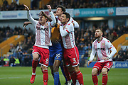 Hayden White of Mansfield Town (16) Harry Beautyman of Stevenage (8) and Joe Martin of Stevenage (1) jump for a cross during the EFL Sky Bet League 2 match between Mansfield Town and Stevenage at the One Call Stadium, Mansfield, England on 18 November 2017. Photo by Mick Haynes.