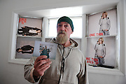 Kevin Cox holds out a photo of him and his daughters that survived the flooding of Hurricane Sandy in his Broad Channel home, Nov. 3, 2012.