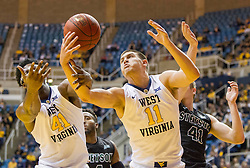 Nov 20, 2015; Morgantown, WV, USA; West Virginia Mountaineers forward Nathan Adrian rebounds a loose ball during the first half against the Stetson Hatters at WVU Coliseum. Mandatory Credit: Ben Queen-USA TODAY Sports