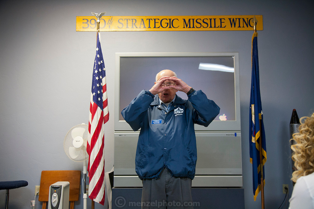 Tour guide at the Titan Missile Museum, Green Valley, Arizona. When the SALT Treaty called for the de-activation of the 18 Titan missile silos that ring Tucson, volunteers at the Pima Air Museum asked if one could be retained for public tours. After much negotiation, including additional talks with SALT officials, the Green Valley complex of the 390th Strategic Missile Wing was opened to the public. Deep in the ground, behind a couple of 6,000 pound blast doors is the silo itself. The 110 foot tall missile weighed 170 tons when it was fueled and ready to fly.