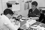 Medical staff writing up patients notes, Nether Edge Hospital, Sheffield.