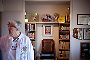 Docent Dorothy Rucker stands in front of a display case in one of the original model homes, which is now the Del Webb Sun Cities Museum, in Sun City, Arizona. The home was built in 1959 and opened in 1960 on Sun City's opening day January 1, 1960.