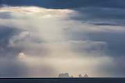 Islands in light rays, captured on my way back from Vestmannaeyjar, Iceland | Øyer i lysstråler, fotografert på vei tilbake fra Vestmannaeyjar på Island.