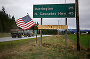 A highway sign refers to the mudslide on Highway 530 in Arlington, Washington March 28, 2014.  Rescue officials said the death toll from a catastrophic mudslide in Washington state is soon expected to climb far higher, as some residents voiced anger that they were prevented from helping in the initial disaster response six days ago.   REUTERS/Rick Wilking (UNITED STATES)