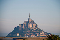 The Abbey of Mont St. Michel and the medieval village on it's island, seen from across the marshes.