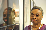 "Marion Sheppard, vision impaired photographerv next to Box Portrait of herself, at Artist Reception for Seeing with Photography Collective SWPC, a group of visually impaired, sighted and totally blind photographers based in NYC, on Saturday, April 28, 2012, at African American Museum, Hempstead, New York, USA, and hosted by Long Island Center of Photography. Aperture published the group's ""Shooting Blind: Photographs by the Visually Impaired"" in 2005."