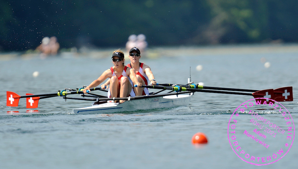 (STROKE) DEBORAH BIRRER & (BOW) FABIENNE ALBRECHT (BOTH SWITZERLAND) COMPETE IN THE WOMEN'S LIGHTWEIGHT DOUBLE SCULLS DURING REGATTA ROWING WORLD CUP ON ROTSEE LAKE IN LUCERN, SWITZERLAND...SWITZERLAND , LUCERN , JULY 09, 2010..( PHOTO BY ADAM NURKIEWICZ / MEDIASPORT )..PICTURE ALSO AVAIBLE IN RAW OR TIFF FORMAT ON SPECIAL REQUEST.