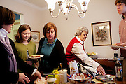 (L-R) Tracey Brown, Annie Brown, 9, Annie Groeber, Linda Groeber, 67, and Evan Brown, 13, prepare food for lunch during a family visit to their grandmother in Lutherville-Timonium, Maryland on Wednesday, January 13, 2010. As she ages Linda has relied more on her daughters Tracey Brown and Annie Groeber to help with day-to-day tasks.