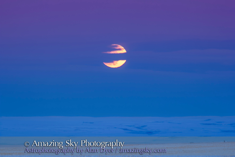 The rising Full Moon of February 10, 2017, the &ldquo;Snow&rdquo; Moon, and actually in penumbral eclipse, though the shadowed area of the disk is behind cloud here. Clouds hid the Moon when it was just coming up on the horizon. The penumbral eclipse was at maximum at moonrise for here in Alberta. Later, some darkening of the northern edge of the Moon could be seen visually. <br /> <br /> Shot with the Canon 60Da and 200mm lens and 1.4x tele-extender.