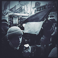Anti-government protesters occupy Maidan Square against police and government supporters on December 13, 2013 in Kiev, Ukraine.  Thousands of protesters have taken to the streets since Ukrainian president Viktor Yanukovych announced a decision to suspend a trade and partnership agreement with the European Union to enter a customs union with Russia.