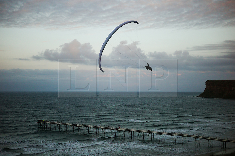 &copy; Licensed to London News Pictures.18/10/15<br /> Saltburn, UK. <br /> <br /> A paraglider flies using the northerly onshore wind blowing off the north sea to rise above the cliff face at Saltburn by the Sea.<br /> <br /> Photo credit : Ian Forsyth/LNP