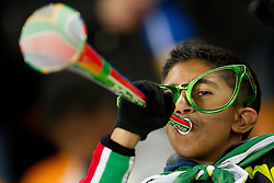 A Brazil fan blows a vuvuzela prior to the 2010 FIFA World Cup South Africa Group G Second Round match between Brazil and République de Côte d'Ivoire on June 20, 2010 at Soccer City Stadium in Soweto, suburban Johannesburg, South Africa. (Photo by Vid Ponikvar / Sportida)