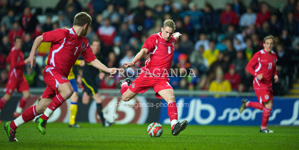 SWANSEA, WALES - Wednesday, March 3, 2010: Wales' Jack Collison in action against Sweden during the international friendly match at the Liberty Stadium. (Photo by David Rawcliffe/Propaganda)