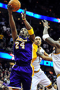 Feb. 16, 2011; Cleveland, OH, USA; Los Angeles Lakers shooting guard Kobe Bryant (24) drives to the basket against the Cleveland Cavaliers during the fourth quarter at Quicken Loans Arena. The Cavaliers beat the Lakers 104-99. Mandatory Credit: Jason Miller-US PRESSWIRE