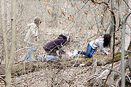 Girl Scouts climb a hill while on a mini-hike during Program Aide (PA) training at the Girl Scouts Urban Campus in Dayton, Saturday, March 3, 2012.