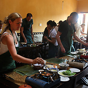 Tourists prepare food at a Vietnamese cooking class run by renowned Vietnamese chef Ms Trinh Diem Vy at her restaurant The Morning Glory, Hoi An, Vietnam. Hoi An is an ancient town and an exceptionally well-preserved example of a South-East Asian trading port dating from the 15th century. Hoi An is now a major tourist attraction because of its history. Hoi An, Vietnam. 5th March 2012. Photo Tim Clayton