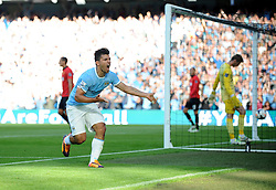 Manchester City's Sergio Aguero celebrates his goal. - Photo mandatory by-line: Dougie Allward/JMP - Tel: Mobile: 07966 386802 22/09/2013 - SPORT - FOOTBALL - City of Manchester Stadium - Manchester - Manchester City V Manchester United - Barclays Premier League