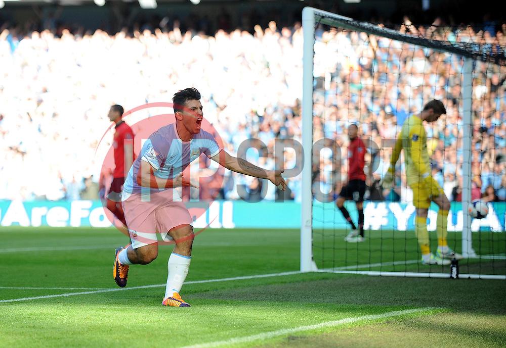 Manchester City's Sergio Aguero celebrates his goal. - Photo mandatory by-line: Dougie Allward/JMP - Tel: Mobile: 07966 386802 22/09/2013 - SPORT - FOOTBALL - City of Manchester Stadium - Manchester - Manchester City V Manchester United - Barclays Premier League