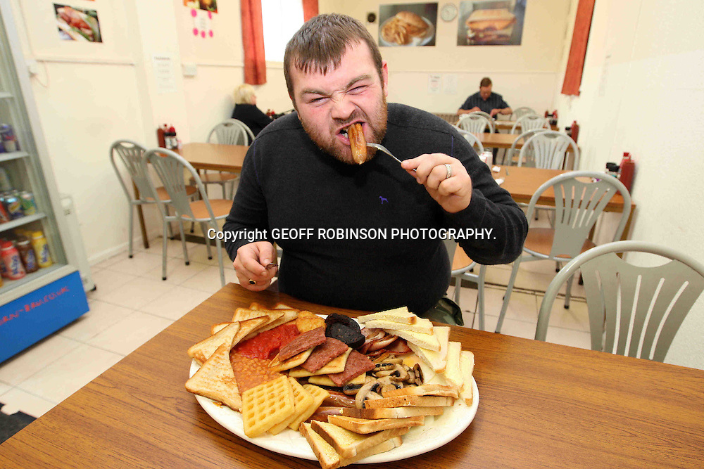 PIC SHOWS STEVEN MAGEE WITH THE 'BIG ONE' BREAKFAST AT THE HUNGRY HOSSEE CAFE IN CORBY,NORTHANTS...  A man has become the FIRST person to eat the world's BIGGEST English breakfast...Steven Magee, 29, is the only person in six years who has been able to demolish the giant fry-up, which weighs a whopping THREE KILOS...At least 60 customers have tried to devour The Big One, which contains a heart-stopping 7,500 calories - THREE TIMES the recommended daily amount for an average male...The gut-busting breakfast includes three sausages, three beef burgers, three fried eggs, three rashers of bacon, three slices of black pudding, three square sausages, three portions of beans and three portions of mushrooms...It is accompanied by three potato waffles, three potato scones, three hash browns, three portions of fried bread, three rounds of bread and butter and three rounds of toast...The big breakfast takes up the whole three foot griddle when it is cooked at the Hungry Hossee Cafe in Corby, Northants, and is offered for FREE to anyone that manages to eat every mouthful...SEE COPY CATCHLINE First man to eat world's biggest breakfast