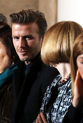 David Beckham talks to Anna Wintour in the front row  of the Victoria Beckham  show at New York Fashion Week for Autumn/Winter 2013 , Sunday, 10th February 2013. Photo by: Stephen Lock / i-Images