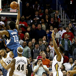 Feb 27, 2016; New Orleans, LA, USA; Minnesota Timberwolves guard Andrew Wiggins (22) draws a foul from New Orleans Pelicans guard Eric Gordon (10) during the final seconds of the fourth quarter of a game at  the Smoothie King Center. The Timberwolves defeated the Pelicans 112-110.  Mandatory Credit: Derick E. Hingle-USA TODAY Sports