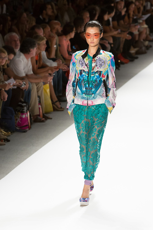 Aqua lace pants with elastic cuffed hems, matching top, and print jacket. By Custo Barcelona at the Spring 2013 Fashion Week show in New York.
