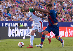September 30, 2018 - Valencia, U.S. - VALENCIA, SPAIN - SEPTEMBER 30: John Guidetti forward of Deportivo Alaves competes for the ball with Rober Pier, defender of Levante UD during the La Liga match between Levante UD and Deportivo Alaves at Estadio Ciutat de Valencia on September 30, 2018, in Valencia, Spain. (Photo by Carlos Sanchez Martinez/Icon Sportswire) (Credit Image: © Carlos Sanchez Martinez/Icon SMI via ZUMA Press)