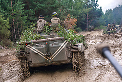 July 3, 2018 - Rivne Region, Ukraine - Soldiers drive IFVs along a muddy road during exercises of the 128th Separate Mountain Infantry Brigade at a military training area in Rivne Region, northwestern Ukraine, July 3, 2018. Ukrinform. (Credit Image: © Gudak/Ukrinform via ZUMA Wire)