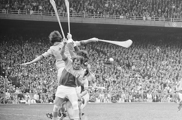 A group of players all jump with hurls raised in an attempt to gain possession of the slitor during the All Ireland Senior Hurling Final, Cork v Wexford in Croke Park on the 5th September 1976. Cork 2-21, Wexford 4-11.