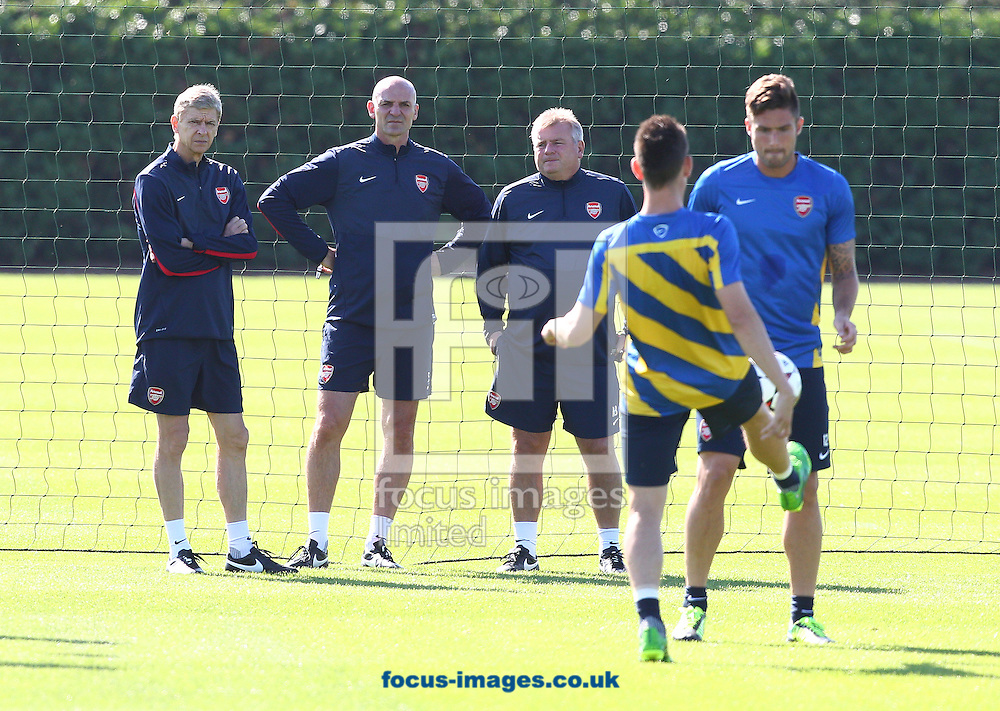 Picture by Paul Terry/Focus Images Ltd +44 7545 642257<br /> 20/08/2013<br /> Arsenal manager, Arsene Wenger ( L ) pictured with Steve Bould ( 2nd L ) and Neil Banfield ( 2rd L ) during Arsenal training at London Colney, London.