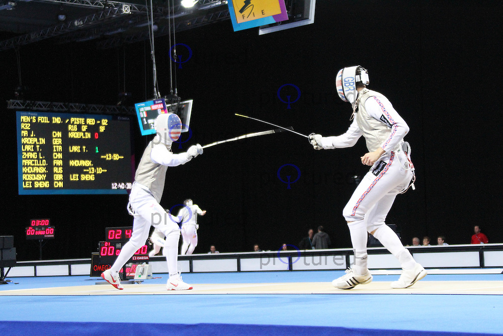 Men's Foil Fencing - Richard Kruse (GBR) vs Alexander Massialas (USA) - London 2012 Olympics test event, ExCel, London, UK. 26 November 2011. Contact: Rich@Piqtured.com +44(0)7941 079620 (Picture by Richard Goldschmidt)