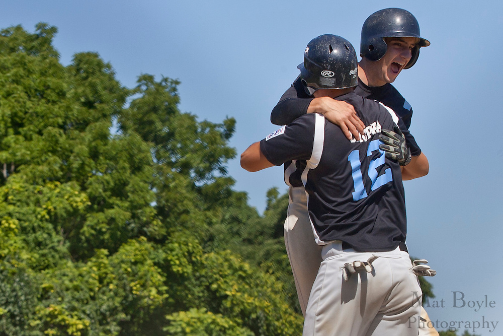 Pennsylvania's Jake Granteed and Bart Chupka (12) dive into each others arms after scoring in the 3rd inning during the finals of the Eastern Regional Senior League tournament between Pennsylvania and Maryland held in West Deptford on Thursday, August 11.