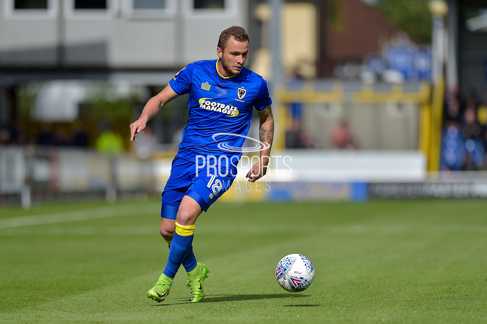AFC Wimbledon Midfielder, Dean Parrett (18) during the EFL Sky Bet League 1 match between AFC Wimbledon and Portsmouth at the Cherry Red Records Stadium, Kingston, England on 9 September 2017. Photo by Adam Rivers.