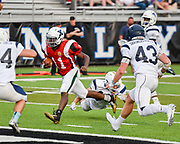 South Squad's Ike Irabor, from Xaverian Brothers High School, moves the ball to the endzone during the Shriner's All-Star Football Classic at Bentley University in Waltham, June 22, 2018.   [Wicked Local Photo/James Jesson]