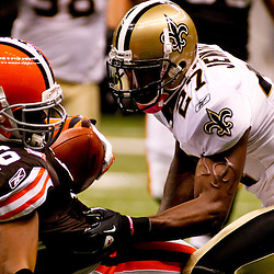 Oct 24, 2010; New Orleans, LA, USA; Cleveland Browns wide receiver Josh Cribbs (16) is tackled by New Orleans Saints cornerback Malcolm Jenkins (27) during the first half at the Louisiana Superdome. Mandatory Credit: Derick E. Hingle