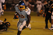 Oxford High's Mont Dean (22) runs vs. Charleston in Charleston, Miss. on Friday, August 26, 2011. Oxford won.